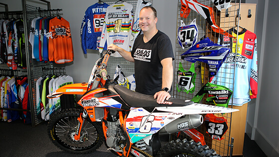 Wisja Lamers, founder of motocross graphics expert WLM Design, posed in their showroom.