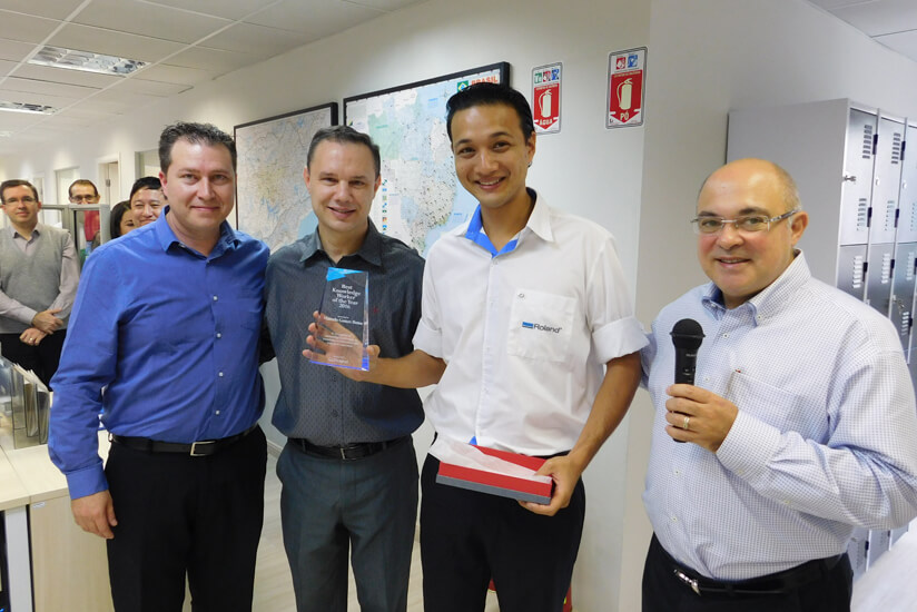 "Roland DG Brasil Technical Manager Alan Carmona Pepe (far left) commented: ""The ceremony was a positive influence to the professionalism and teamwork of Brazil's service team. I hope to see Botao continuing to provide customers with great after-sales service."""
