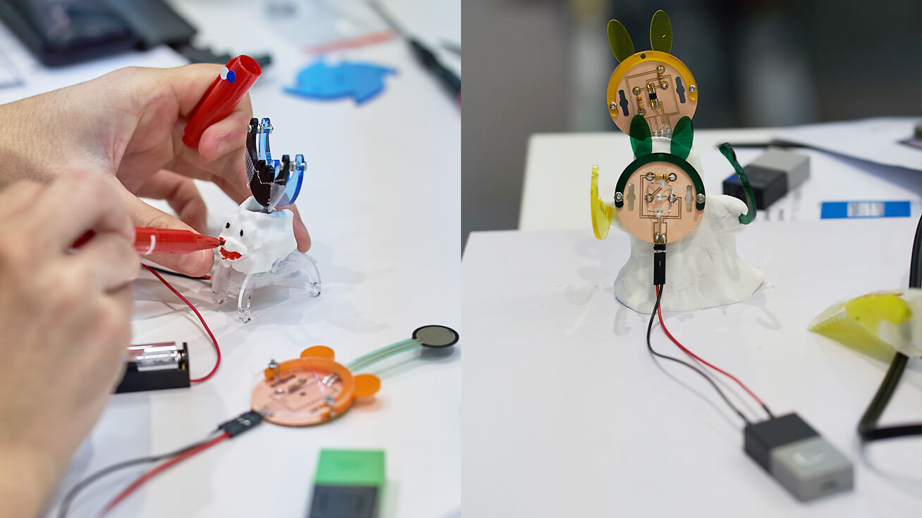 Left: Accessories available to make creations more exciting were included in designs. Right: One design turned on an LED when pointing at the sensor.