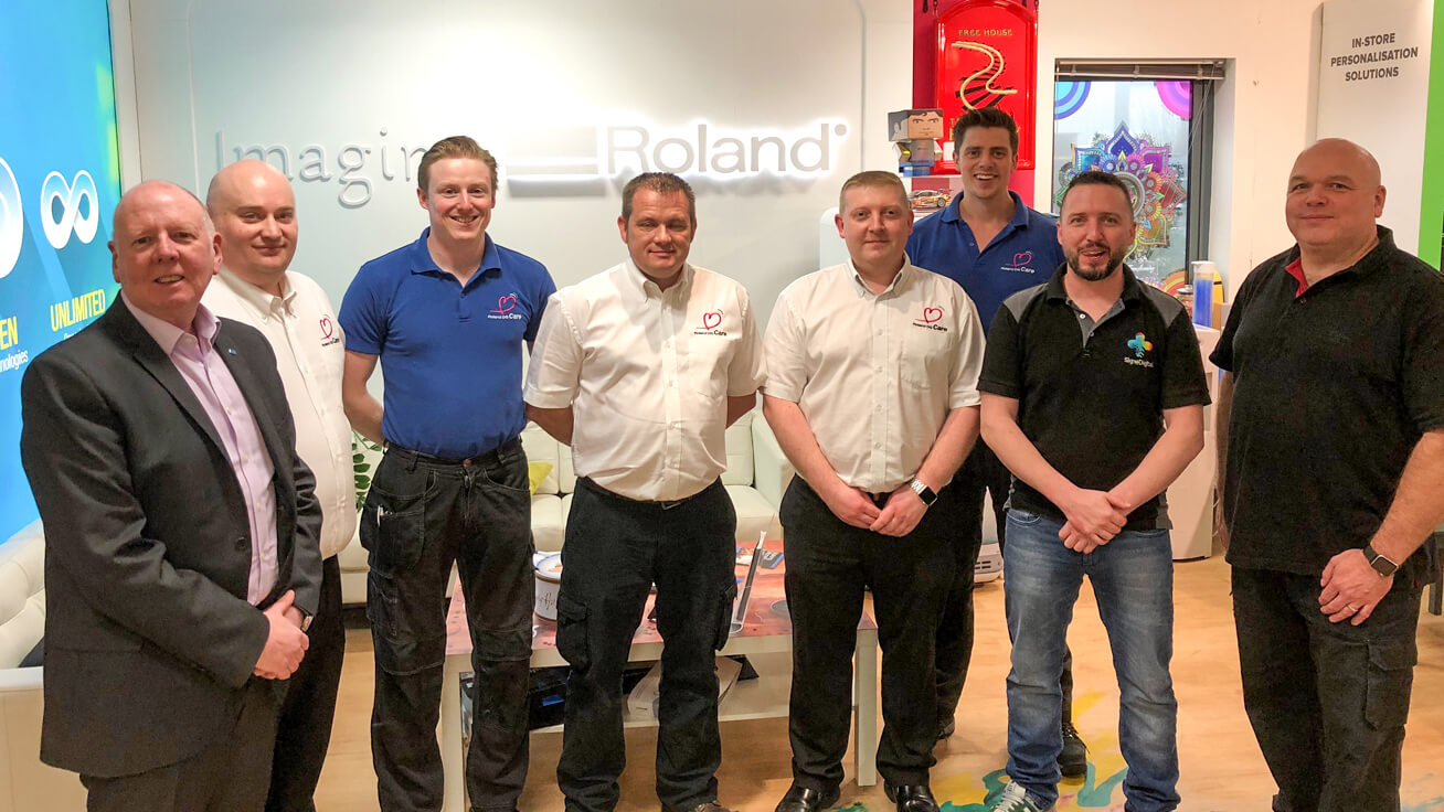 Roland DG (U.K.) staff celebrates Wrench (fourth from the left) winning the local competition.