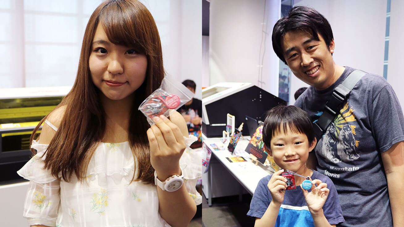 Visitors showing off their one-of-a-kind key chains.