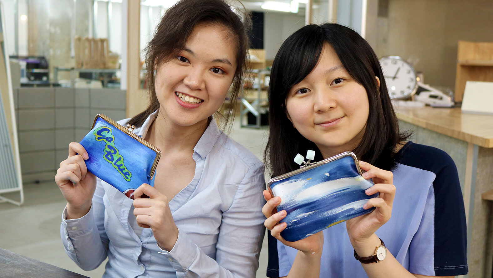 Two senior students, King Yuk Chiu (right) and Jinyu Wang (left), from the University of Michigan at Makers' Base Chiba.