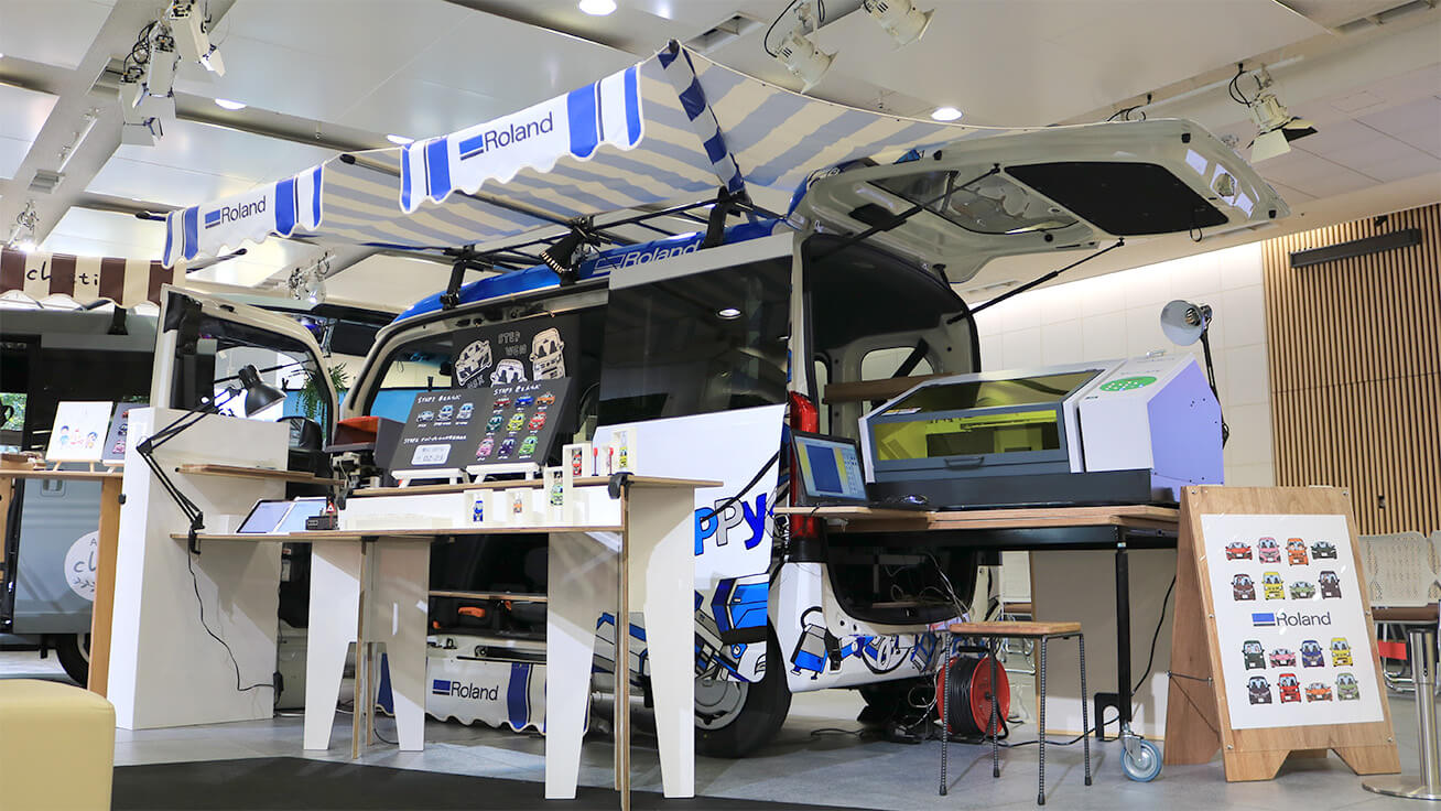 The custom van loaded with UV printers and other tools is displayed at various locations as a workshop or pop-up booth so visitors can create their very own accessories.