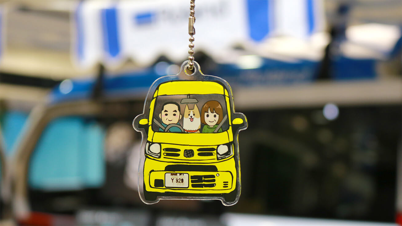 One-of-a-kind car-shaped key chains printed with illustrated portraits or facial photos.