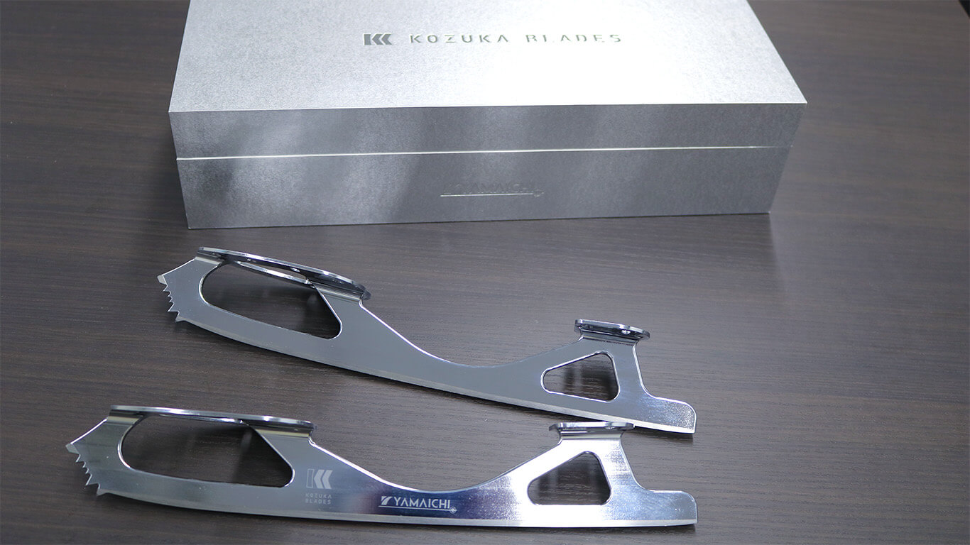 Completed blades (bottom) and their packaging that resembles a solid steel block (top).