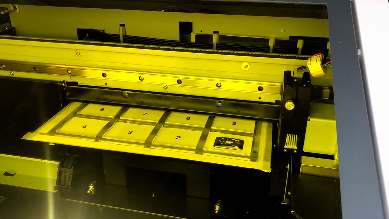 The LEF-12i UV printer customizing a MAMORIO FUDA with photos.