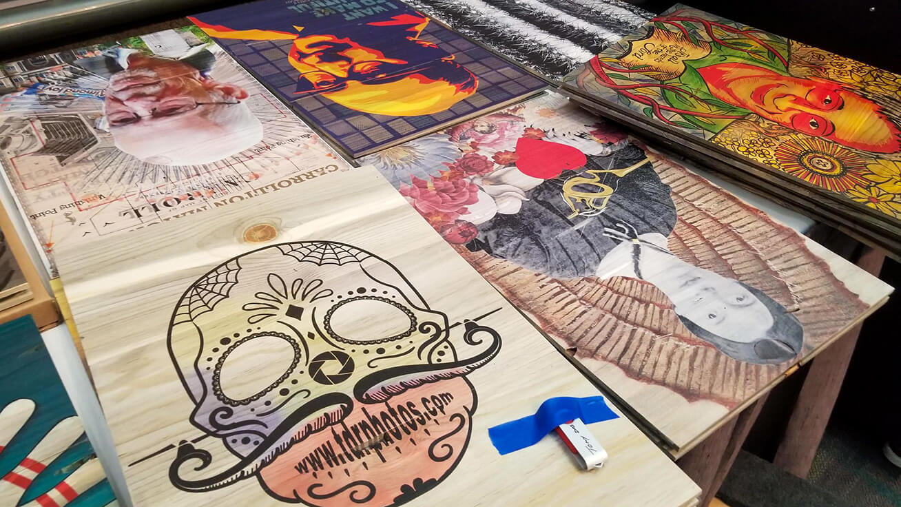 Dia De Los Muertos designs on wood from the pre-show workshop — all printed with VersaUV flatbed technology.