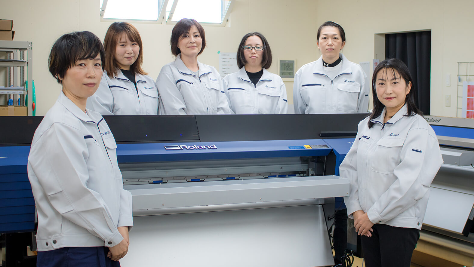 AIMARK President Seiko Kayakabe (front right), Shiho Fujiwara (front left) who is in charge of printing operations and staff members