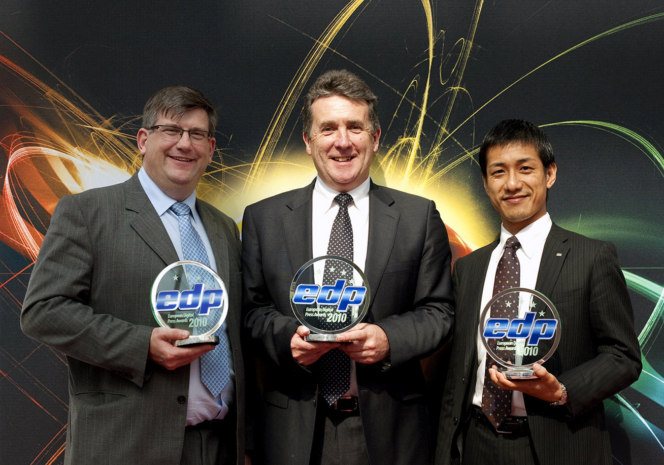 At the Award Ceremony: (from left to right) Brett Newman, Director of Roland DG UK, Jerry Davis, Managing Director of Roland DG UK,  and Kohei Tanabe, Manager of Roland DG Corporation.