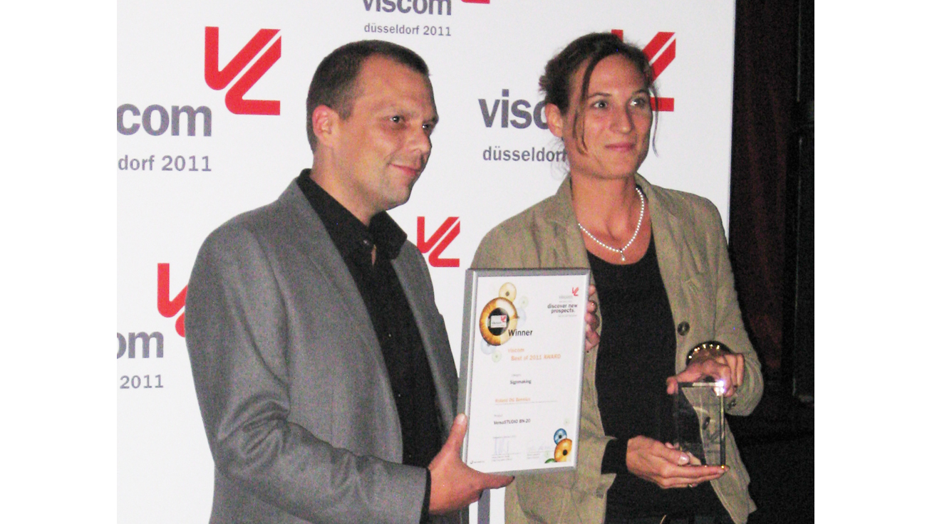 At the award ceremony: (from left to right) Michel Van Vliet, Product Development Manager - Germany of Roland DG Benelux N.V. and Kathrin Schwarz, Sales Manager - Roland DG Deutschland GmbH